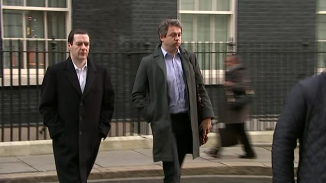 philip hammond and iain duncan smith views on brexit lib downing street ext rupert harrison along from no11 with george osborne mp - ジョージ・オズボーン点の映像素材/bロール