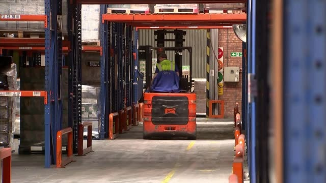 remain and leave campaigners clash over the economy back view of forklift truck along at factory sidebyside warning signs in polish and english... - side by side stock videos & royalty-free footage