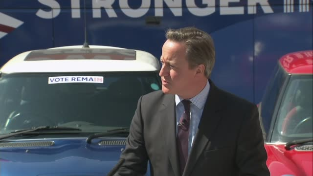 Remain and Leave campaigners clash over the economy ENGLAND London The Oval EXT Yellow mini car blue mini car and red mini car at 'Stronger In' event...