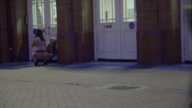 referendum campaign: report from blackpool; england: blackpool: ext / night montage of shots of young people dressed up and dancing and messing about... - film montage stock videos & royalty-free footage
