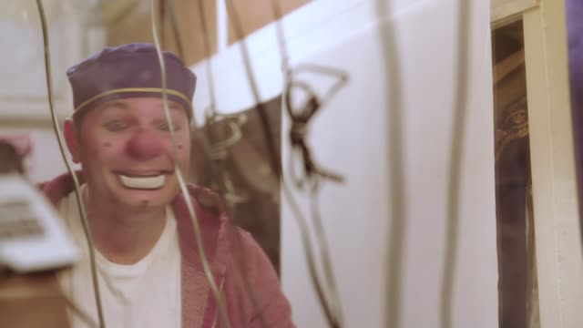 vídeos de stock, filmes e b-roll de report from blackpool int laci endresz speaking sot was paralysed from the neck down laci's dog clown putting on makeup llaci and his wife maureen... - cultura do leste europeu
