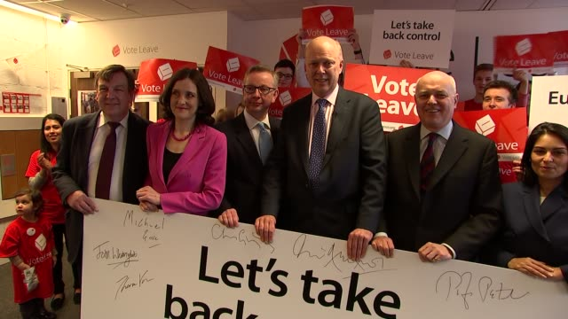 row over legality of david cameron's eu deal date vote leave campaigners including cabinet ministers posing with banner bearing their signatures - brexit stock-videos und b-roll-filmmaterial