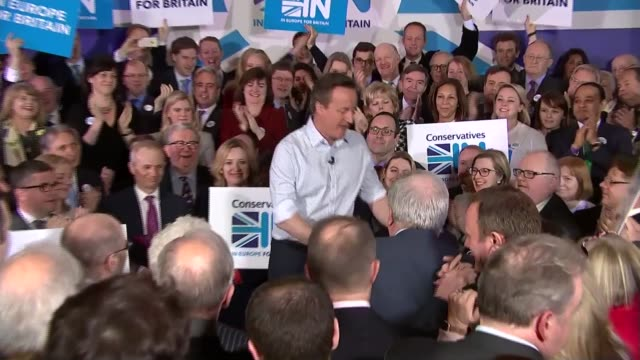 stockvideo's en b-roll-footage met referendum campaign: row over legality of david cameron's eu deal; england: int david cameron mp along to stage, shirt-sleeves rolled up, to address... - mouw