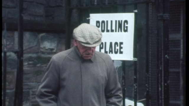 voting nears a close elderly man along by polling station sign during 1975 common market referendum various shots families along by polling stations - european union stock videos and b-roll footage