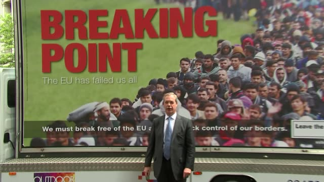 campaigns re-started following jo cox death / row over immigration poster; ext nigel farage out of van and along to stand by poster 'breaking point'... - poster stock-videos und b-roll-filmmaterial