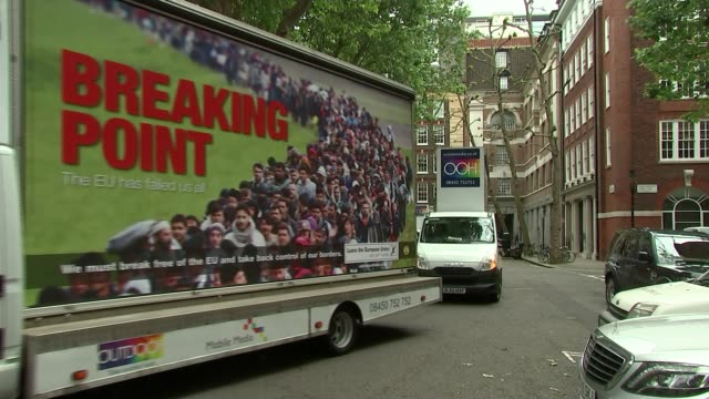 campaigns restarted following jo cox death / row over immigration poster ext **music heard sot** 'breaking point' advert trucks along - music poster stock videos & royalty-free footage
