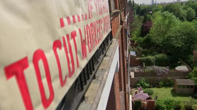 gospel oak neighbours show rival banners; england: london: gospel oak: ext low angle view block of flats with 'vote leave' and 'if you want to cut... - cut video transition stock videos & royalty-free footage
