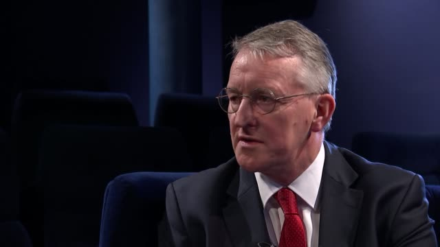 hilary benn set ups and interview benn interview sot on different sides of eu argument in business / benn being shown old leaflets from 1975... - hilary benn stock-videos und b-roll-filmmaterial