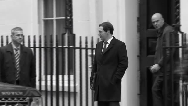 international monetary fund report on dangers of leaving eu lib england london downing street chancellor george osborne leaving number 11 - number 11 stock videos and b-roll footage