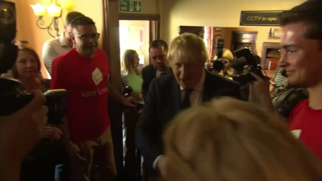 last day of campaign; darlington: **flashlight photography** int boris johnson shaking hands with applauding vote leave supporters as into pub/ boris... - darlington nordostengland stock-videos und b-roll-filmmaterial