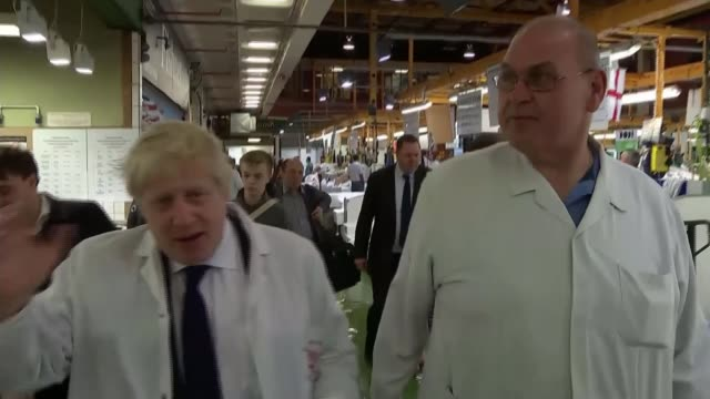 last day of campaign; england: london: billingsgate fish market: int boris johnson mp along with billingstgate worker during visit to billingsgate... - last day stock videos & royalty-free footage