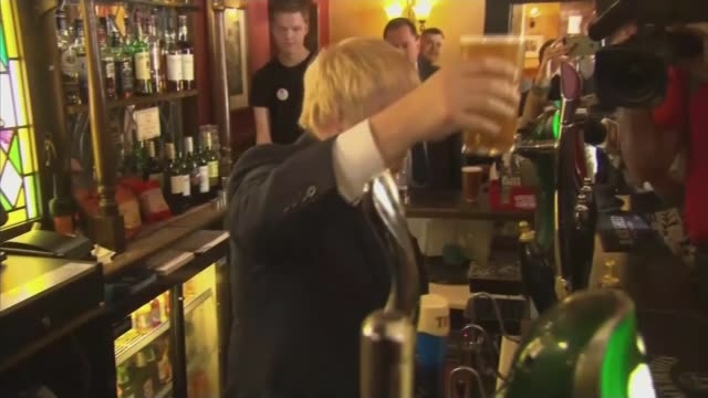 last day of campaign int johnson holding up pint behind bar as 'darlington' graphic overlaid johnson holding pint and speaking to assembled press sot - last day stock videos and b-roll footage