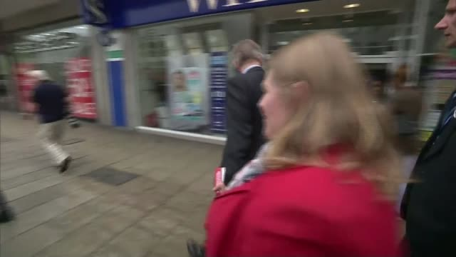 last day of campaign michael gove mp towards along street and along to shake hands with woman cooking food on street sot - last day stock videos and b-roll footage