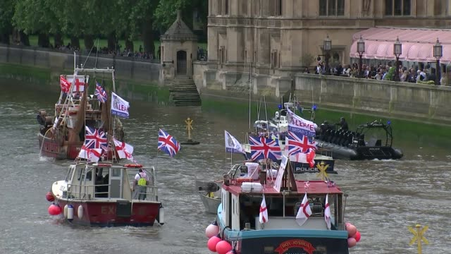 Nigel Farage leads Leave campaign flotilla along River Thames ENGLAND London EXT 'Brexif flotilla' boats sailing up River Thames PAN fishing boats on...