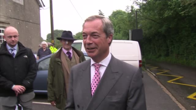 nigel farage polling station arrival and departure; england: kent: westerham: biggin hill: ext nigel farage mep arriving at polling station / farage... - biggin hill stock videos & royalty-free footage