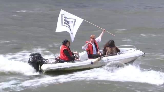 nigel farage's leave campaign flotilla along river thames; various of rival 'in' flotila on small boats disrupting farage's leave flotilla - in... - referendum stock videos & royalty-free footage