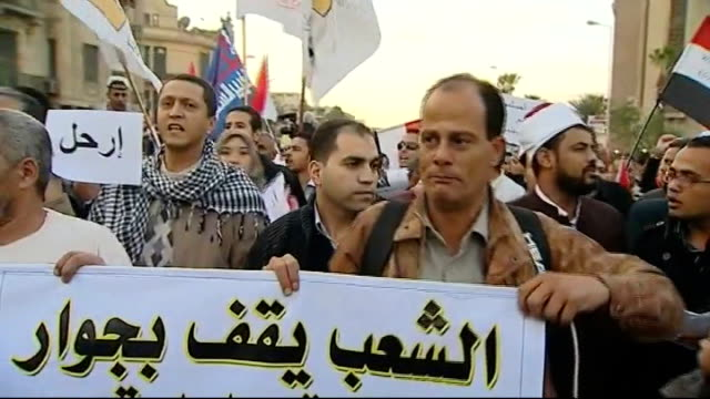 referendum on new constitution day protesters banging drums on street cherif choubachy interview sot opposition supporters outside presidential... - table top shot stock videos and b-roll footage