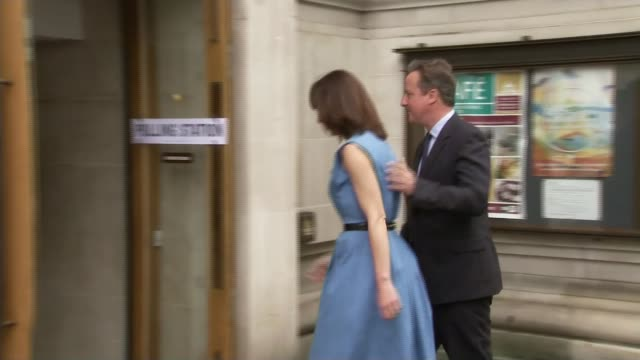 polling day england london methodist central hall ext david cameron mp and his wife samantha cameron arriving at polling station to vote in eu... - 国民投票点の映像素材/bロール