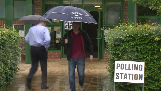 polling day theresa may at polling station england hampshire liphook gvs of polling station with voters arriving and leaving/ int interior of polling... - vallokal bildbanksvideor och videomaterial från bakom kulisserna