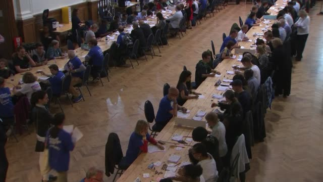 to leave the eu: ' divided britain '; england: london: int various shots ballot counting in hall - referendum stock videos & royalty-free footage
