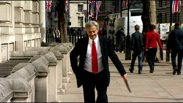 row at cabinet meeting england london ext chris huhne mp along and into cabinet office - クリス ヒューン点の映像素材/bロール