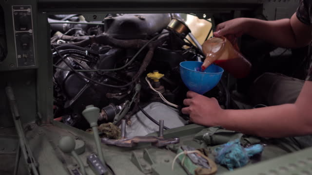 refilling engine oil - motor oil stock videos and b-roll footage