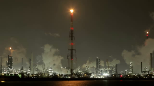 Refineries by the Scheldt river at night