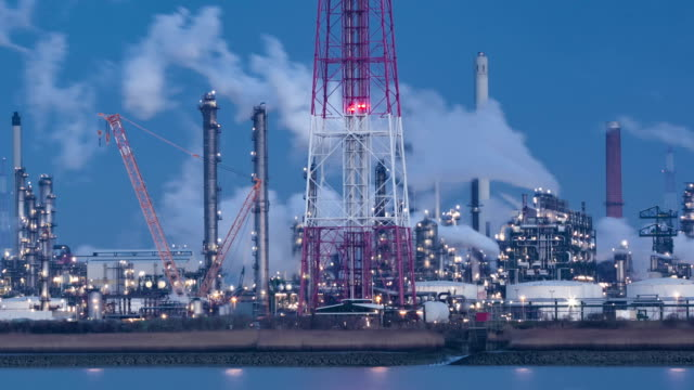 Refineries by the Scheldt river (dusk)