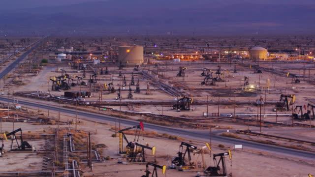 Refinery Among Pump Jacks in South Belridge Oil Field in Kern County, California - Drone Shot