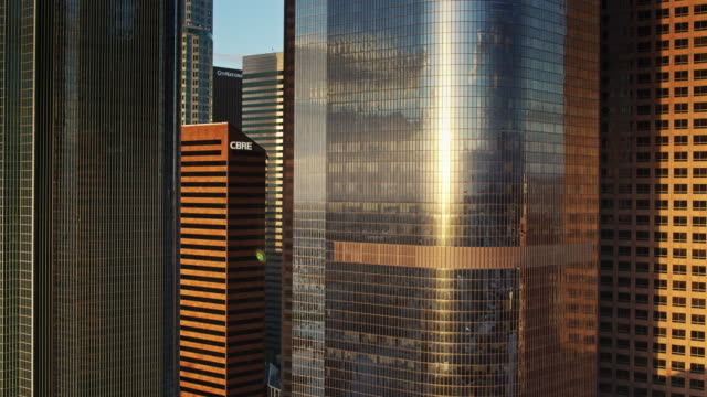 reflected sunlight on office towers - skyscraper stock videos & royalty-free footage