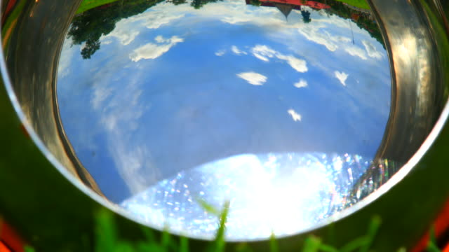 reflected view of clouds and blue sky - bowl stock videos & royalty-free footage