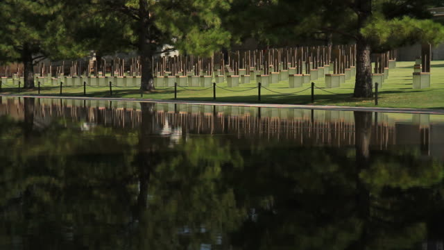 reflecting pool and chair at the okc bombing memorial - alfred p. murrah federal building stock videos & royalty-free footage
