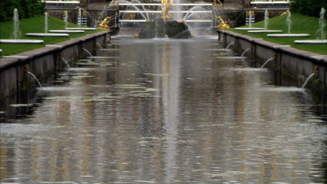 A reflecting pool extends out from the base of Peterhof Palace. Available in HD.