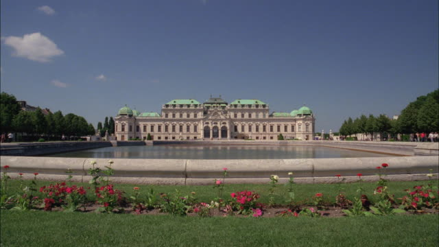 A reflecting pool stretches before Belvedere Palace in Vienna, Austria.