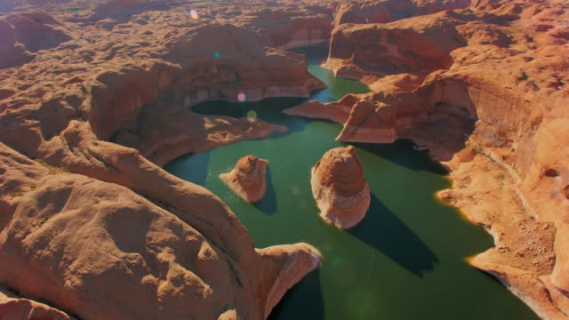 aerial reflection canyon, lake powell, usa at sunset - lago powell video stock e b–roll