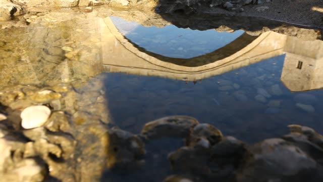 a reflection from water mostar old bridge - religious symbol stock videos & royalty-free footage
