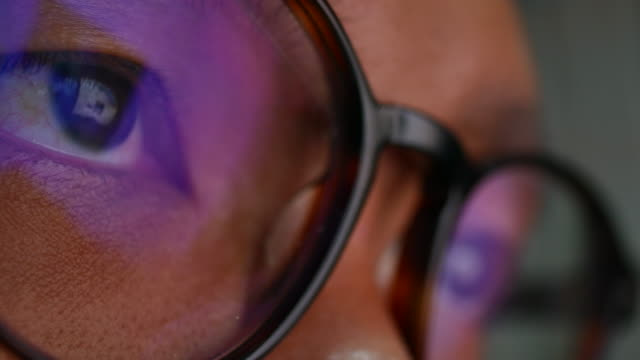 reflection in the eye and glasses of the monitor when you surfing the internet - macro stock videos and b-roll footage