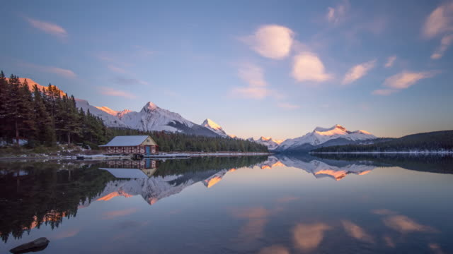 reflection lake sunset timelapse - alberta stock videos & royalty-free footage