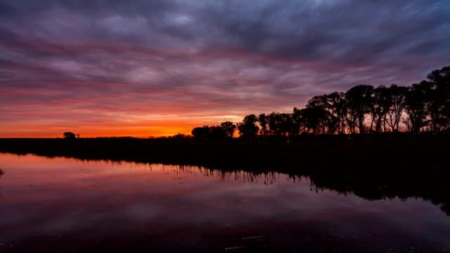 Reflection of a beautiful sunrise on the lake