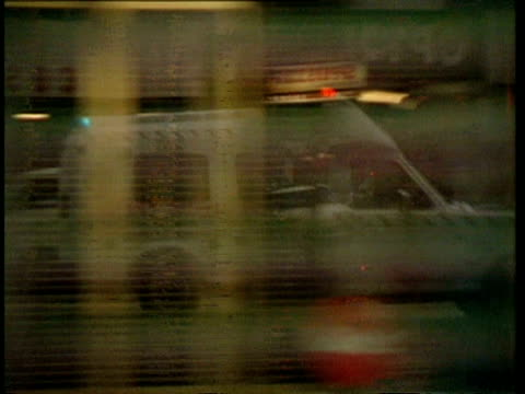 MS Reflection of ambulance in glass windows as it rushes by, Australia