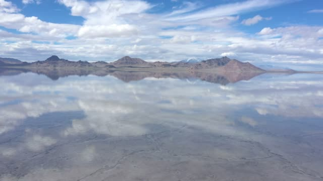 reflection of clouds in water over the bonneville salt flats - salt flat stock videos & royalty-free footage