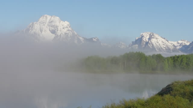 reflection of grand teton in the snake river - grand teton stock videos & royalty-free footage