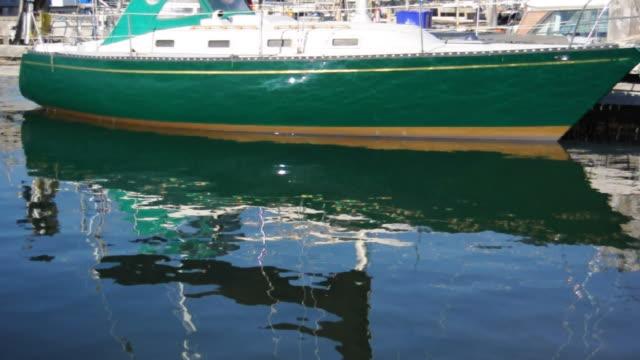 reflection of green sailboat - marina stock videos & royalty-free footage