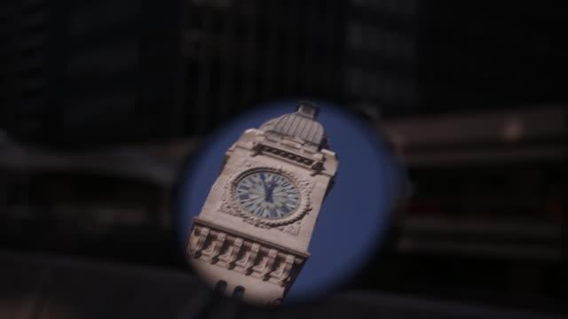 Reflection of historical Paris Gare de Lyon Tower Clock Face in a mirror