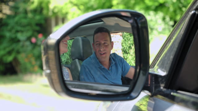 reflection of mature couple in mirror - wing mirror stock videos & royalty-free footage