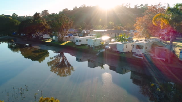 reflection of motor home park. - camper van stock videos & royalty-free footage