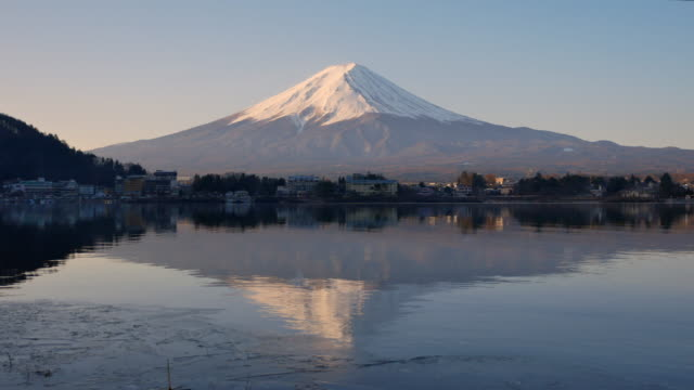 reflection of mt. fuji at lake kawaguchi during sunrise, yamanashi prefecture, japan - mt fuji stock videos & royalty-free footage