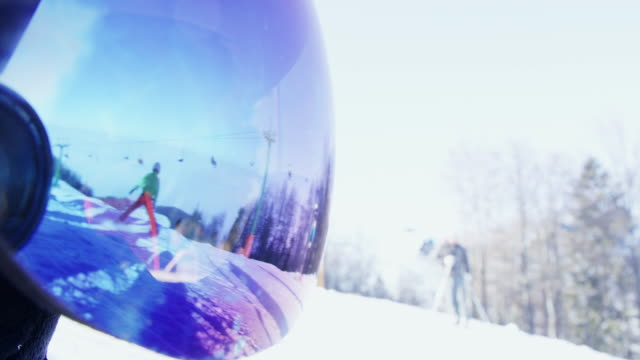 4k reflection of skiers on ski slope in ski goggles - ski goggles stock videos & royalty-free footage