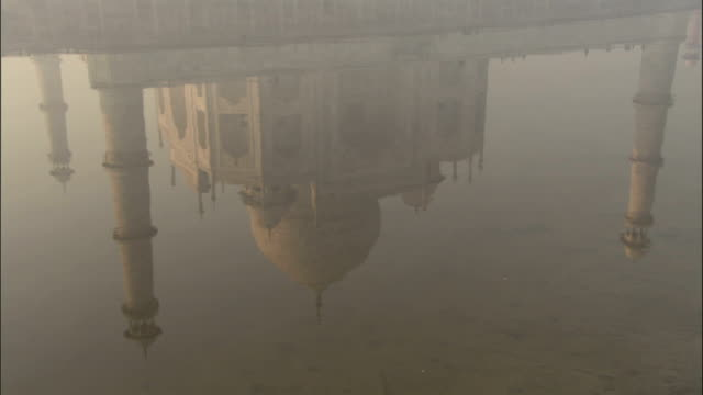 reflection of taj mahal in water available in hd. - agra stock videos and b-roll footage