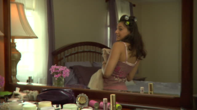 ms, reflection of teenage girl (16-17) standing in front of mirror, trying on prom dress, edison, new jersey, usa - high school prom stock videos and b-roll footage